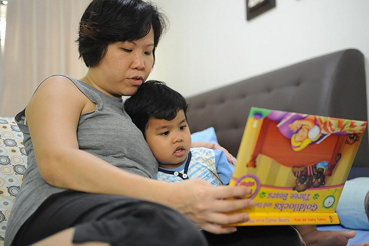 Housewife Cai Shujia often has a chat with her daughter Grace (both left) before the six-year-old goes to sleep. Three-year-old Akaash Xavier's bedtime routine includes a story read by his mum, housewife Fionna Wee (both above).