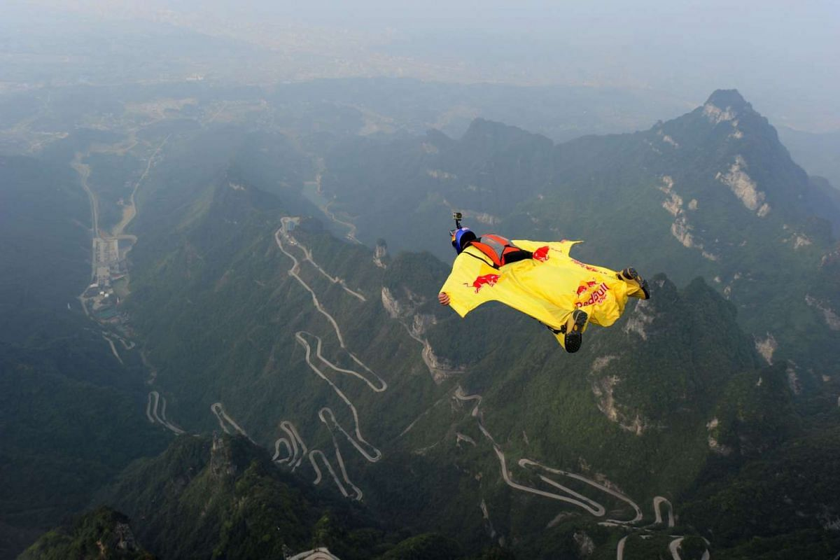 A participant jumping off a platform for a wingsuit flight from Tianmen Mountain in Zhangjiajie, central China's Hunan province. Some 16 participants from 12 countries are taking part in the extreme sport event.
