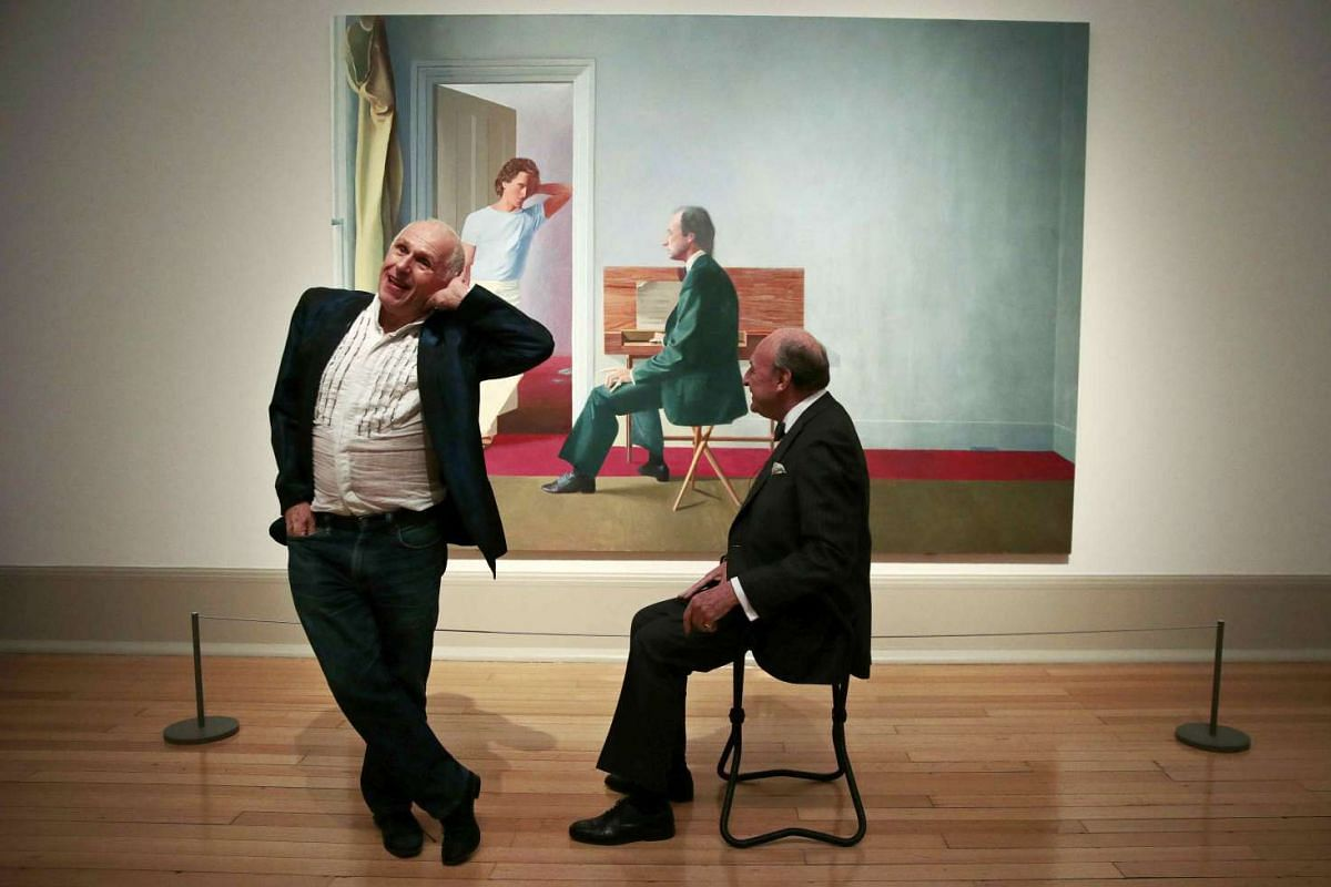 """Ballet dancer Wayne Sleep (L) and book dealer George Lawson pose in front of """"George Lawson and Wayne Sleep"""" by David Hockney at Tate Britain in London, Britain Oct 19, 2015. A recent gift from Hockney for Tate's collection, this is the first time th"""