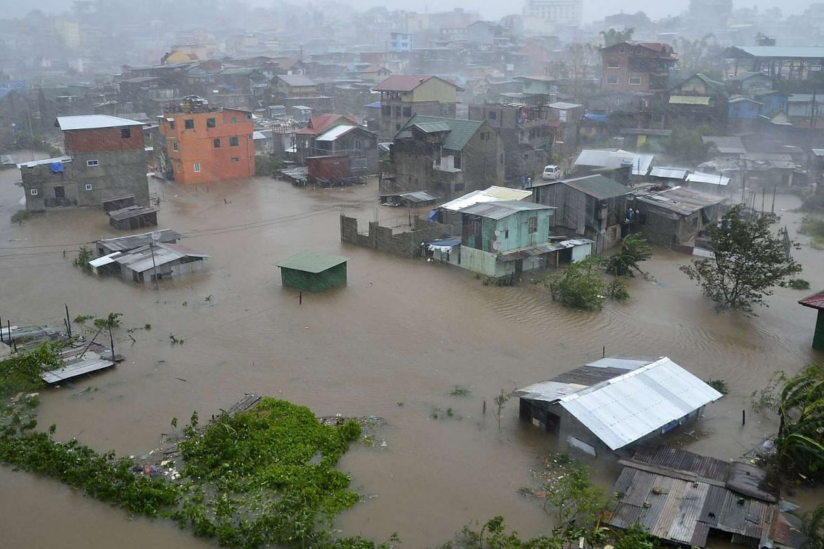 Houses, partially submerged in floodwaters, are seen in City Camp Lagoon at Baguio city on Oct 19.