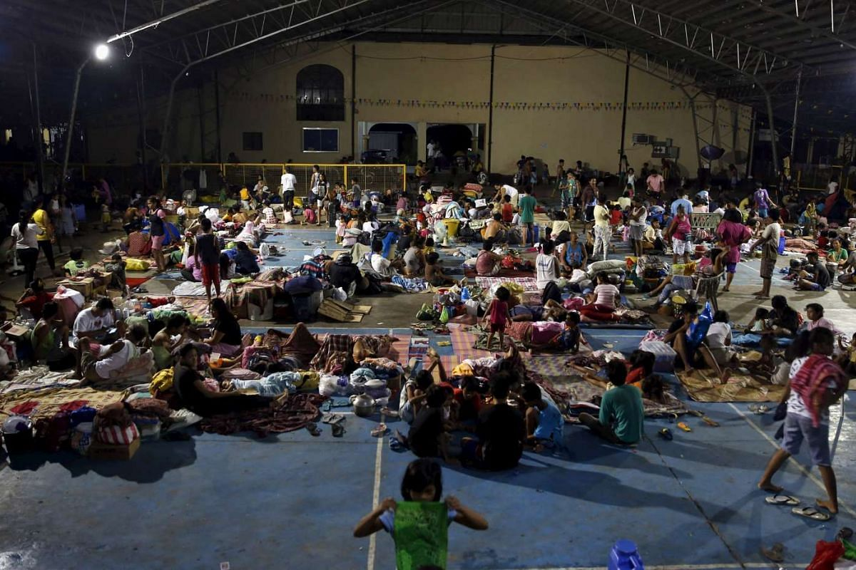 Typhoon victims taking shelter at a public school's gymnasium turned evacuation centre in Cabanatuan city on Oct 19.