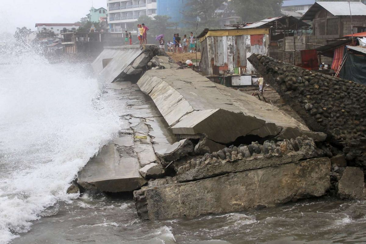A seawall project that protects residents along the shore is destroyed by a strong waves brought by Typhoon Koppu in Ilocanos Norte town on Oct 19.