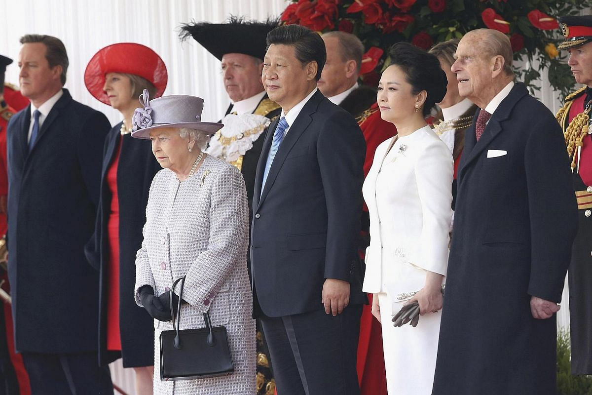 Britain's Queen Elizabeth and Prince Philip (right) standing with Chinese President Xi Jinping (centre) and China's First Lady Peng Liyuan, during a ceremonial welcome at Horse Guards Parade on Oct 20, 2015.