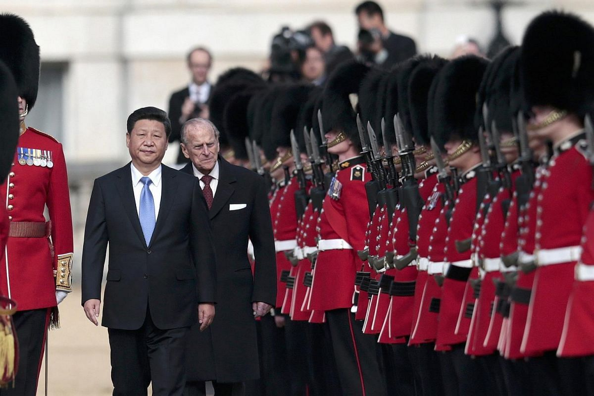 Chinese President Xi Jinping and Britain's Prince Philip reviewing an honour guard during his official welcoming ceremony in London, Britain, on Oct 20, 2015.