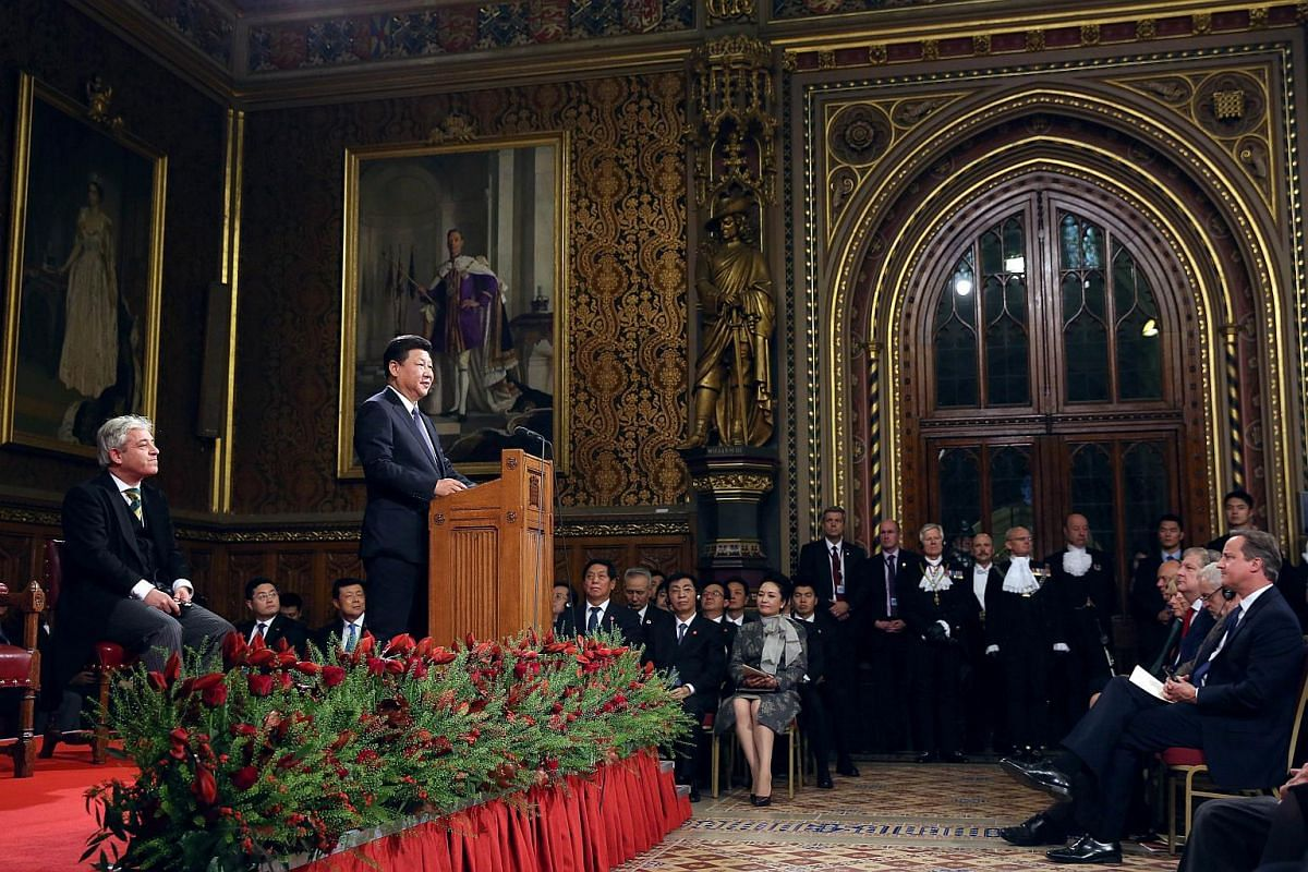 Chinese President Xi Jinping (second, left) delivering a speech as British Prime Minister David Cameron (right), speaker of the House of Commons John Bercow (left) and lawmakers listen in at the Royal Gallery in the Palace of Westminster on Oct 20, 2