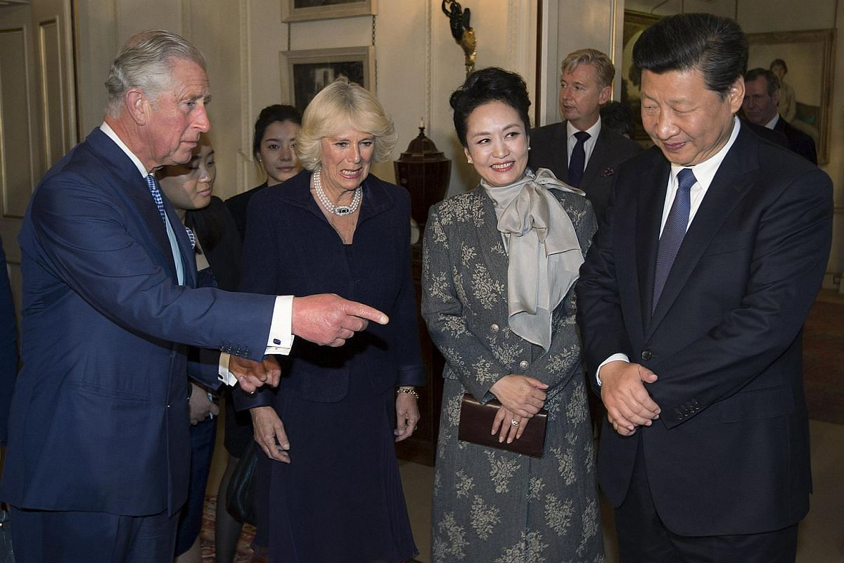 Britain's Prince Charles and his wife Camilla meeting with Chinese President Xi Jinping and his wife Peng Liyuan on Oct 20, 2015.