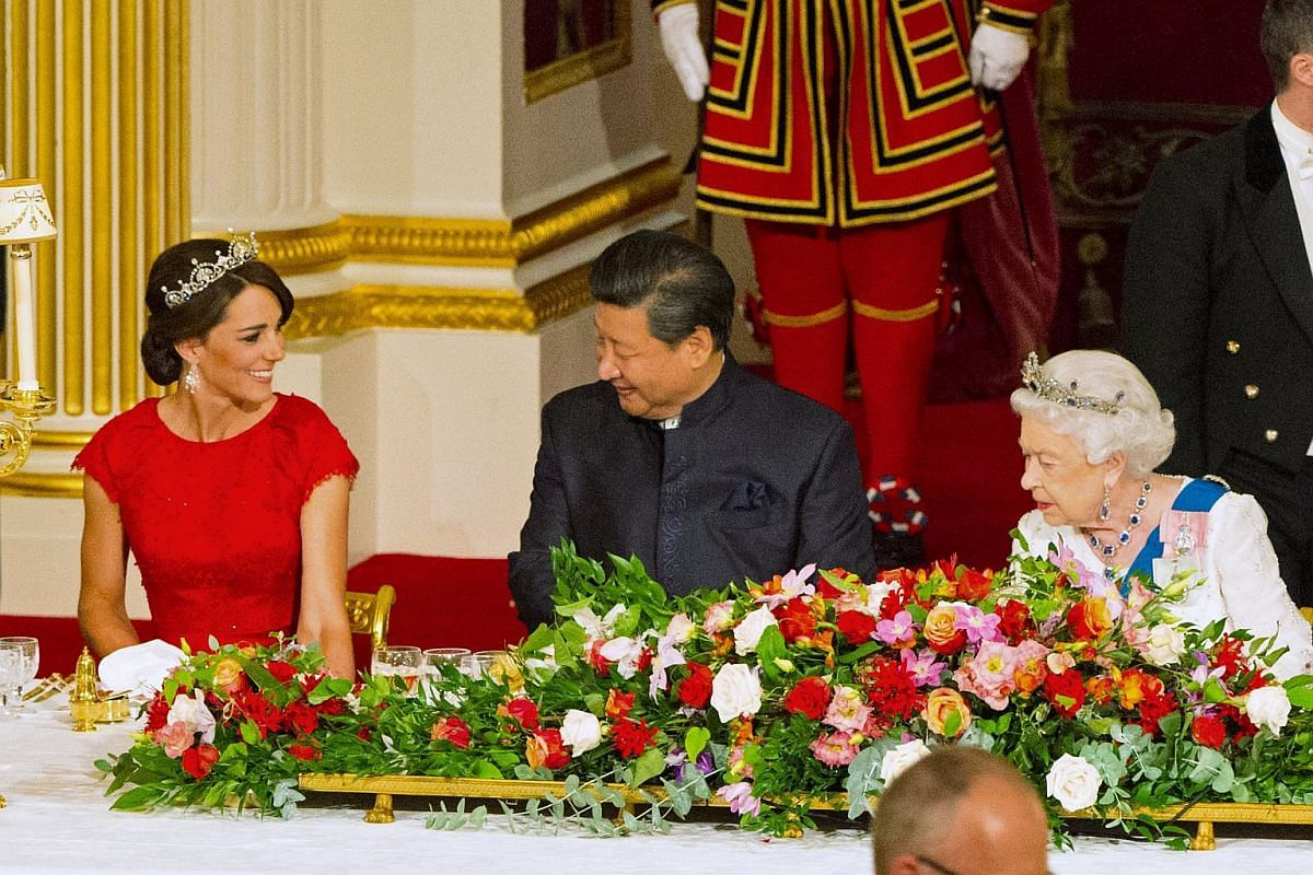 Chinese President Xi Jinping (centre) with the Duchess of Cambridge (left) and Queen Elizabeth II at a state banquet at Buckingham Palace on Oct 20, 2015.