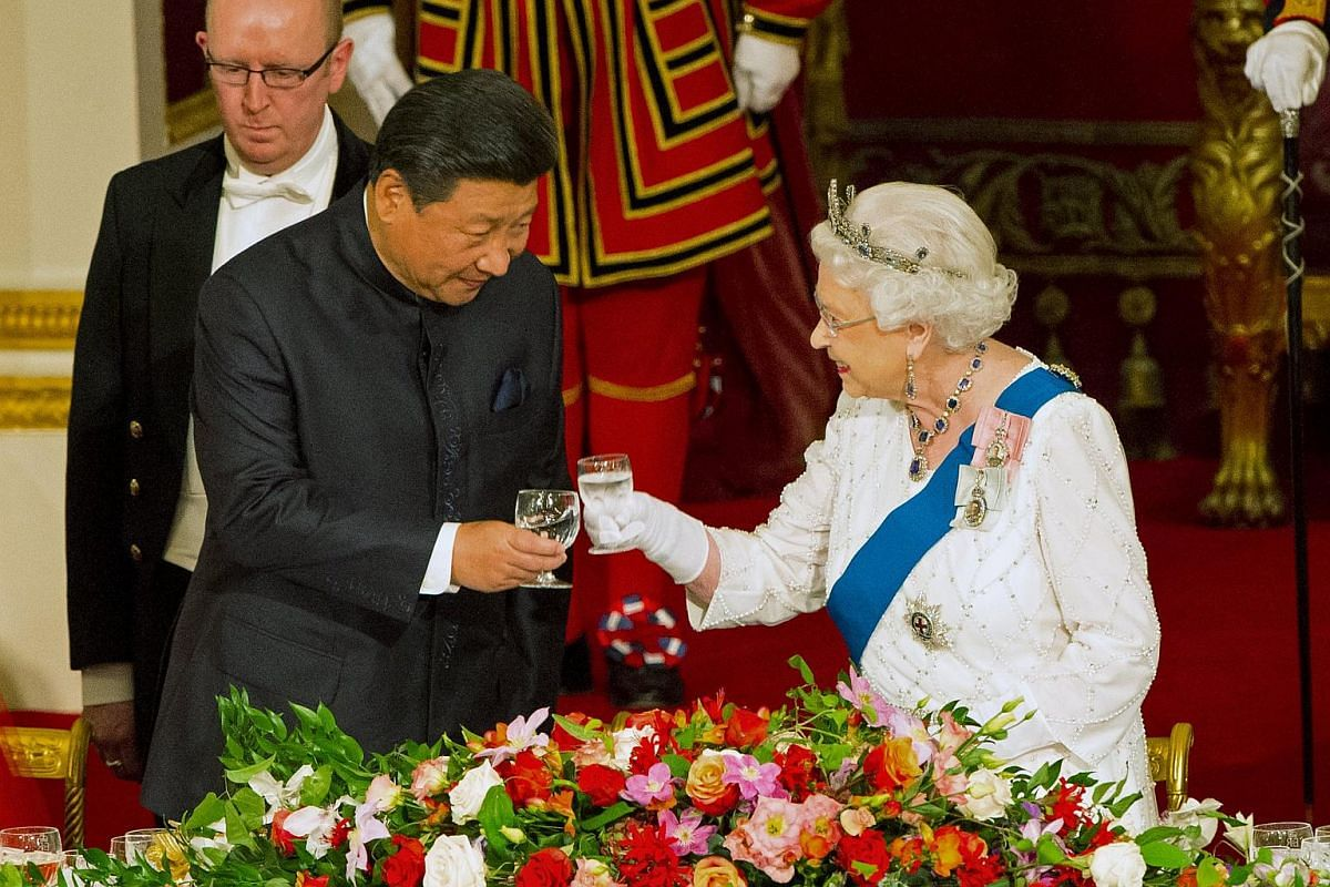 Chinese President Xi Jinping with Queen Elizabeth at a state banquet at Buckingham Palace during the first day of his state visit.