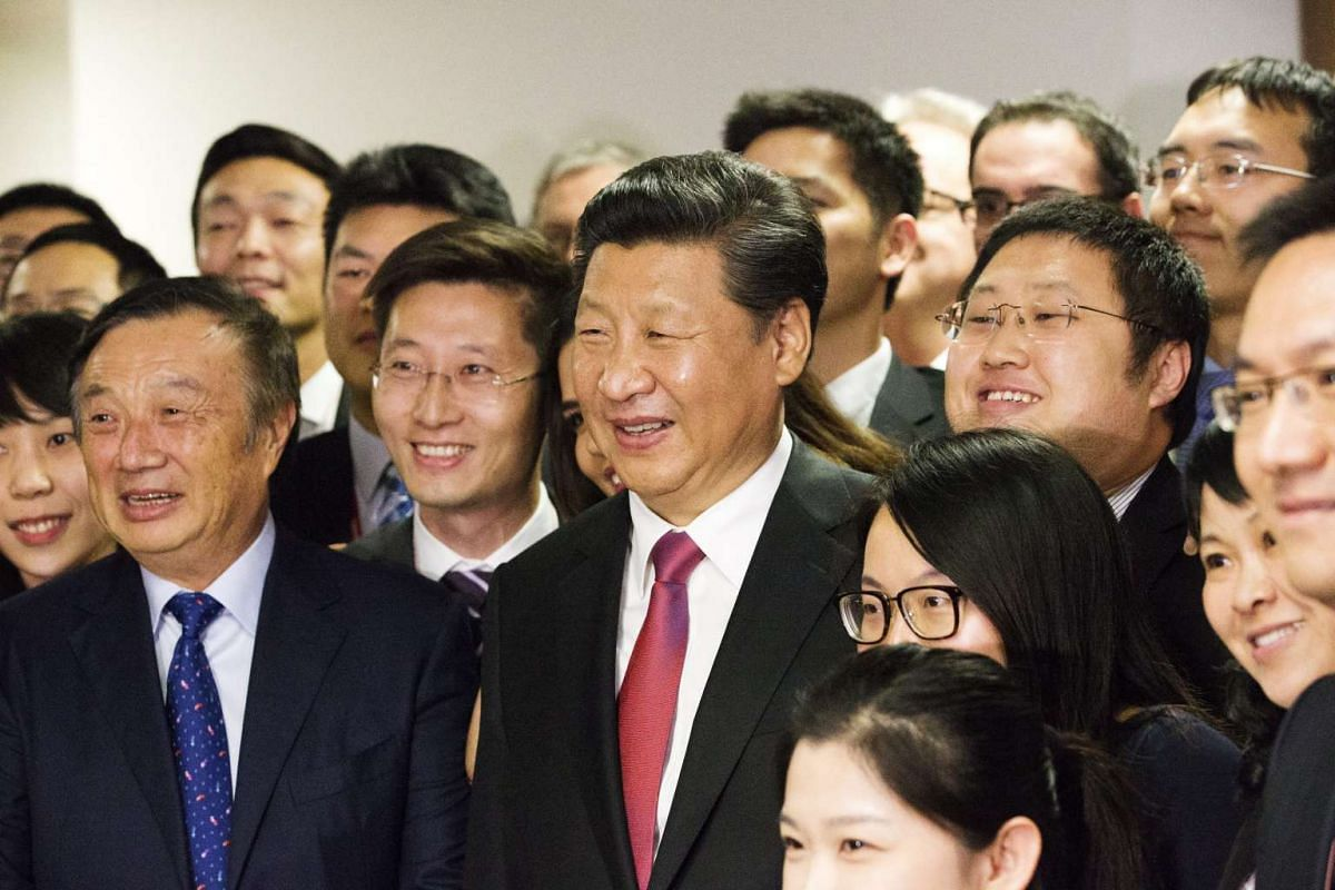 Chinese President Xi Jinping, (centre), with Mr Ren Zhengfei, billionaire and president of Huawei Technologies (left), and employees of Huawei Technologies, at their office in London on Oct 21, 2015.