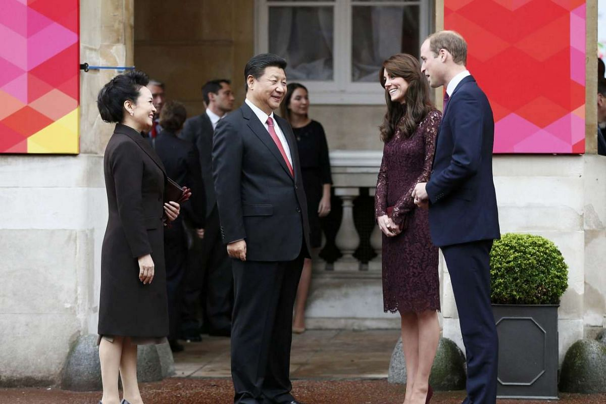 Britain's Prince William and his wife Catherine, Duchess of Cambridge, greeting Chinese President Xi Jinping (centre) and his wife Peng Liyuan as they arrive at Lancaster House in London, Britain on Oct 21, 2015.