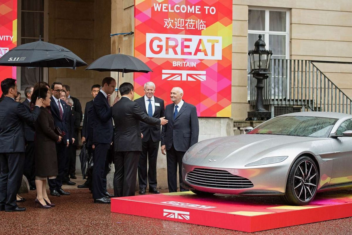 Britain's Prince William, Duke of Cambridge (centre, left), and Chinese President Xi Jinping (centre, right) viewing an Aston Martin DB10 sports car as they arrive at Lancaster House in London, on Oct 21, 2015, to attend a UK-China Creative Collabora
