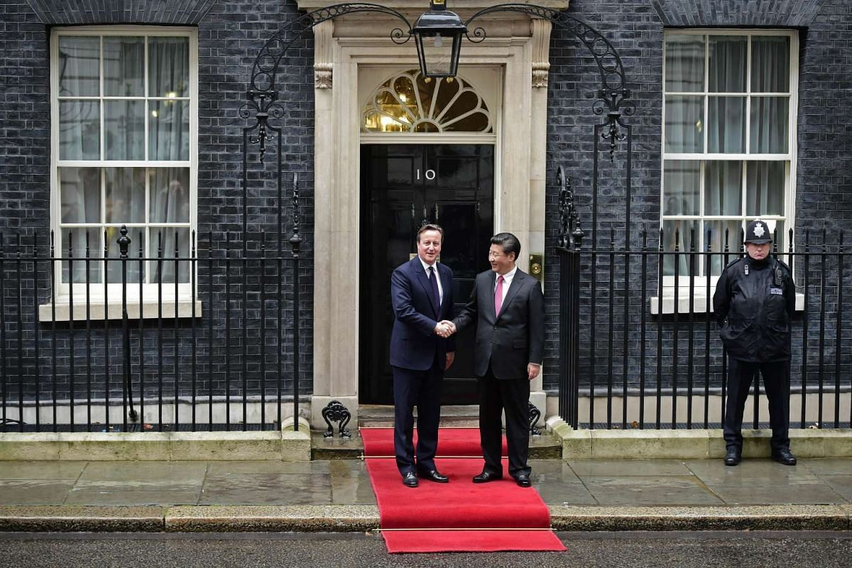 British Prime Minister David Cameron (left) greeting Chinese President Xi Jinping on the steps of 10 Downing Street in central London, on Oct 21, 2015.