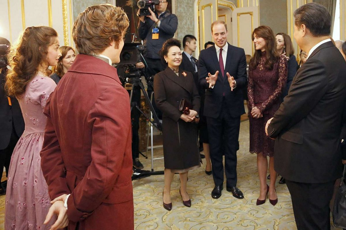 Chinese President Xi Jinping (right) and his wife, Peng Liyuan (centre), standing with Britain's Prince William and Catherine, Duchess of Cambridge as they speak to actors after a performance at Lancaster House in London, Britain on Oct 21, 2015.