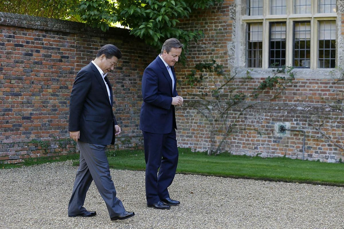 British Prime Minister David Cameron (right) welcoming Chinese President Xi Jinping to Chequers, the Prime Minister's official country residence, near Ellesborough, north-west of London on Oct 22, 2015.