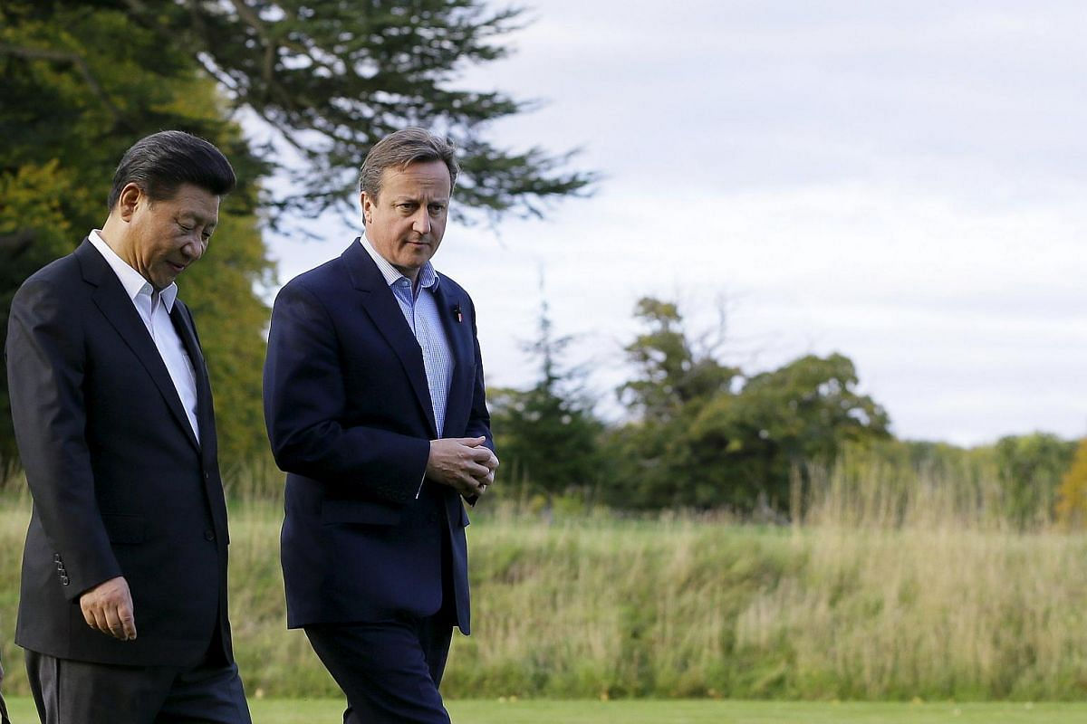 Britain's Prime Minister David Cameron (right) walks with Chinese President Xi Jinping to his official residence at Chequers on Oct 22, 2015.