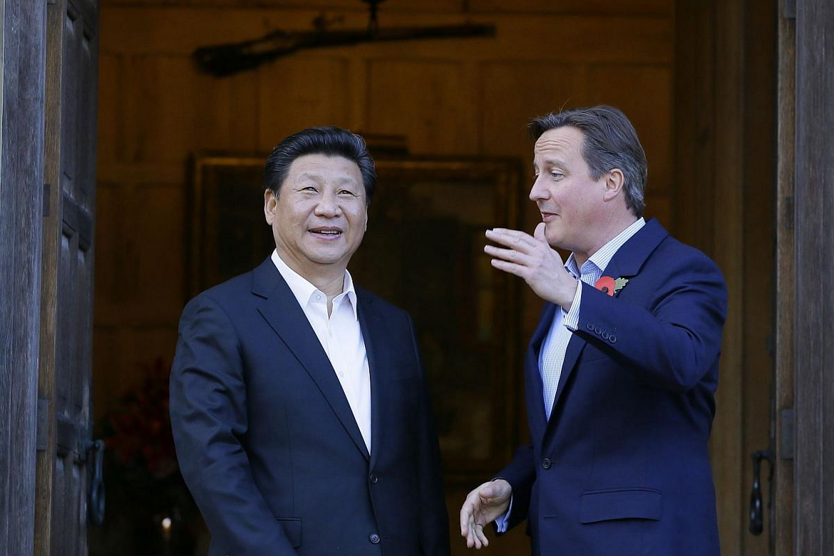 British Prime Minister David Cameron (right) welcomes Chinese President Xi Jinping at Chequers, the Prime Minister's official country residence, near Ellesborough, on Oct 22, 2015.
