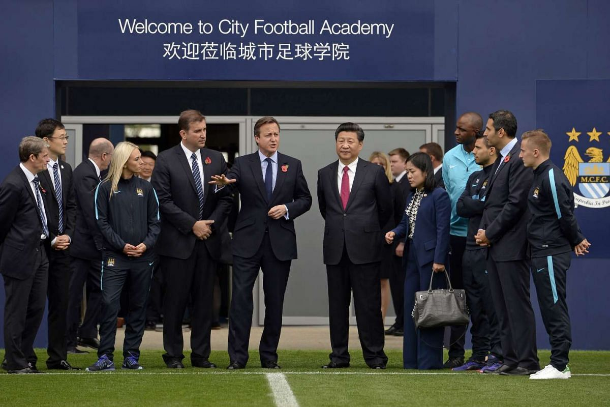 British Prime Minister David Cameron (fifth from the left), and Chinese President Xi Jinping (sixth from right) visit the City Football Academy in Manchester on Oct 23, 2015.