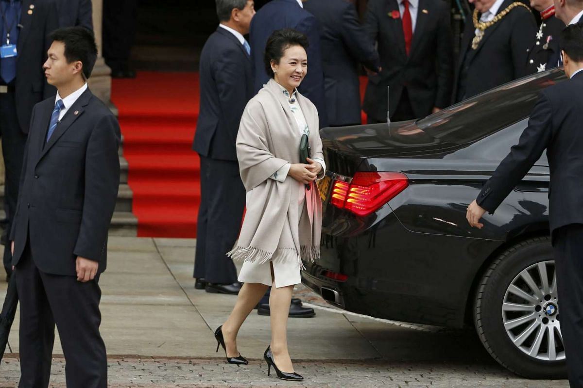 Peng Liyuan, wife of China's President Xi Jinping, leaves Manchester Town Hall on Oct 23, 2015.