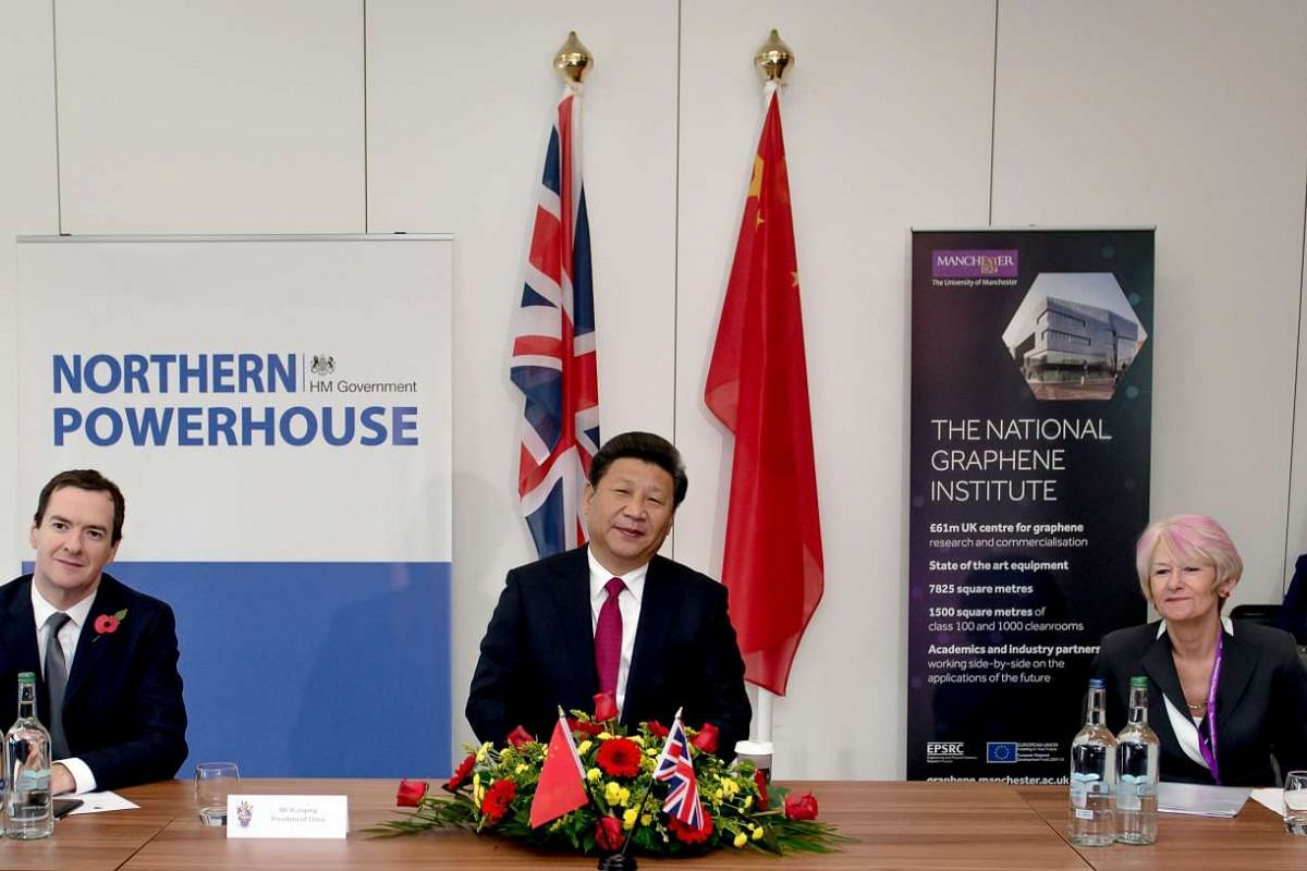 British Chancellor of the Exchequer George Osborne (left), Chinese President Xi Jinping (centre) and President of the University of Manchester, Professor Nancy Rothwell (right), at Britain's National Graphene Institute at the University of Manchester