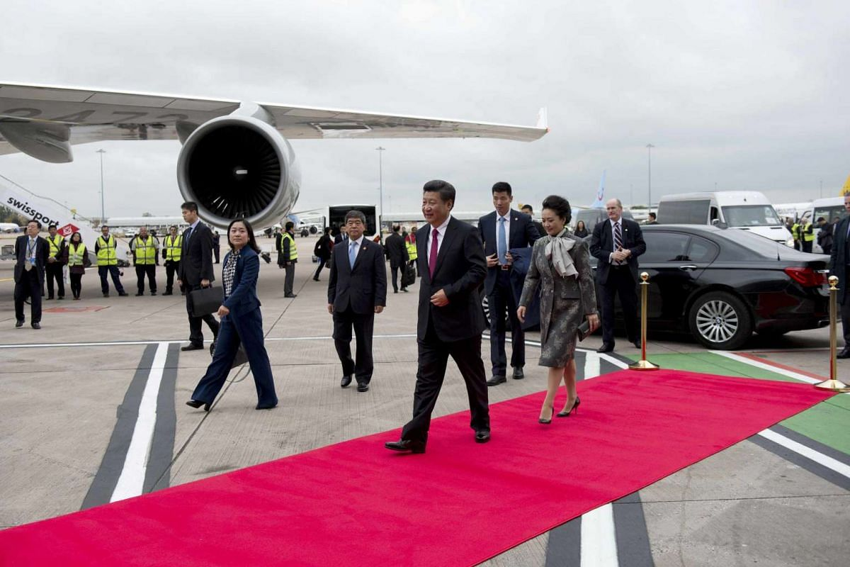 China's President Xi Jinping and his wife Peng Liyuan prepare to board their aircraft to return to China, at Manchester airport, on Oct 23, 2015.