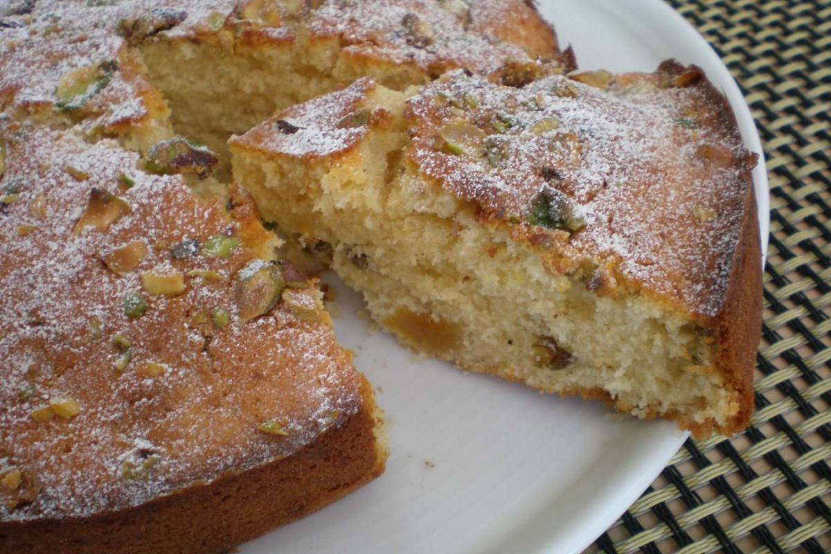 An apricot, pistachio and orange drizzle cake made with dried fruit and assorted nuts from the cupboard.