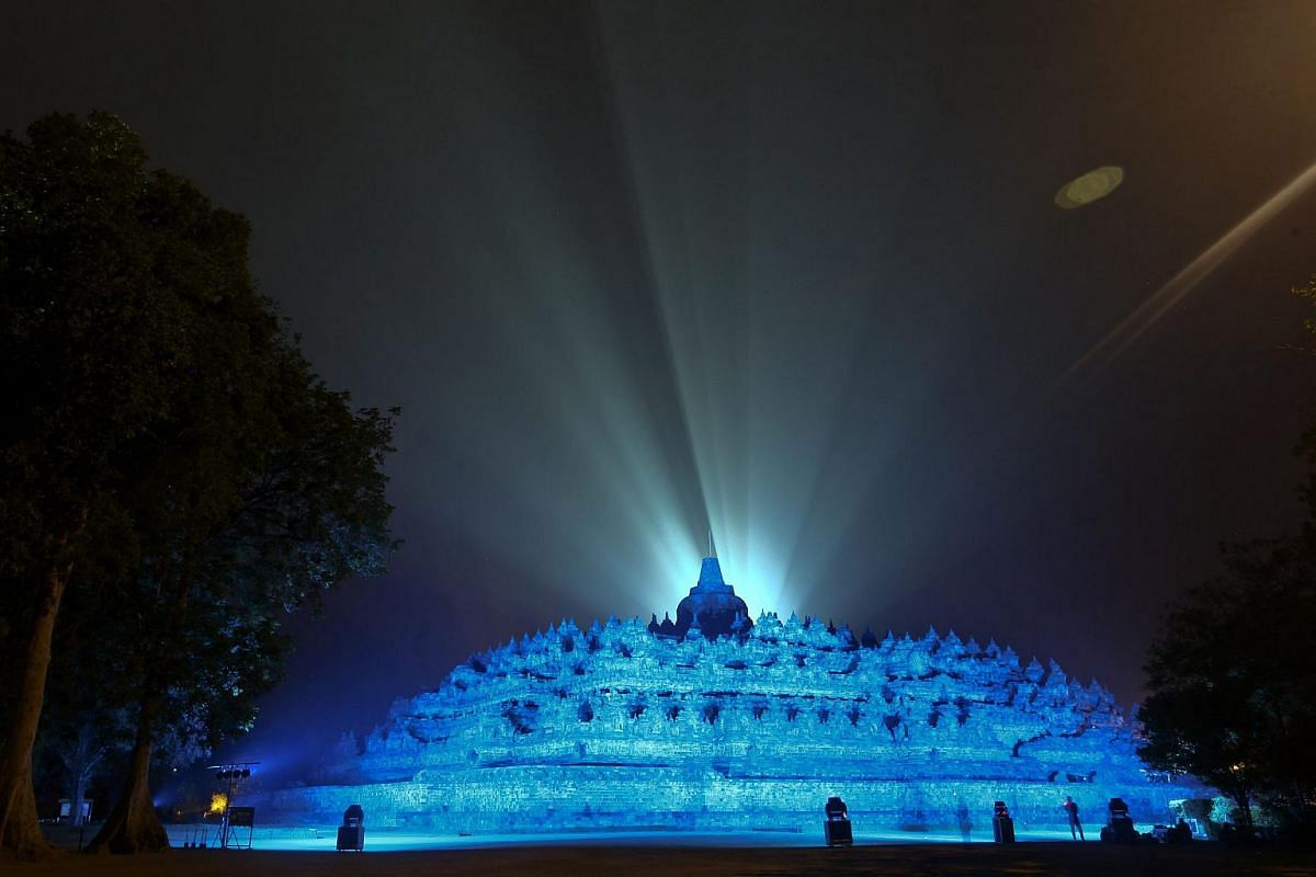Ancient Buddhist Borobudur Temple illuminated in blue, the official color of the United Nations, to mark the 70th anniversary of the UN, in Magelang, Central Java, Indonesia, on Oct 24, 2015.