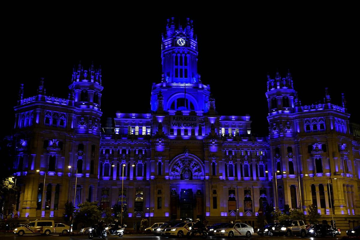 The facade of the Cibeles Palace, the Madrid City Hall illuminated in blue light to celebrate the 70th anniversary of the United Nations.