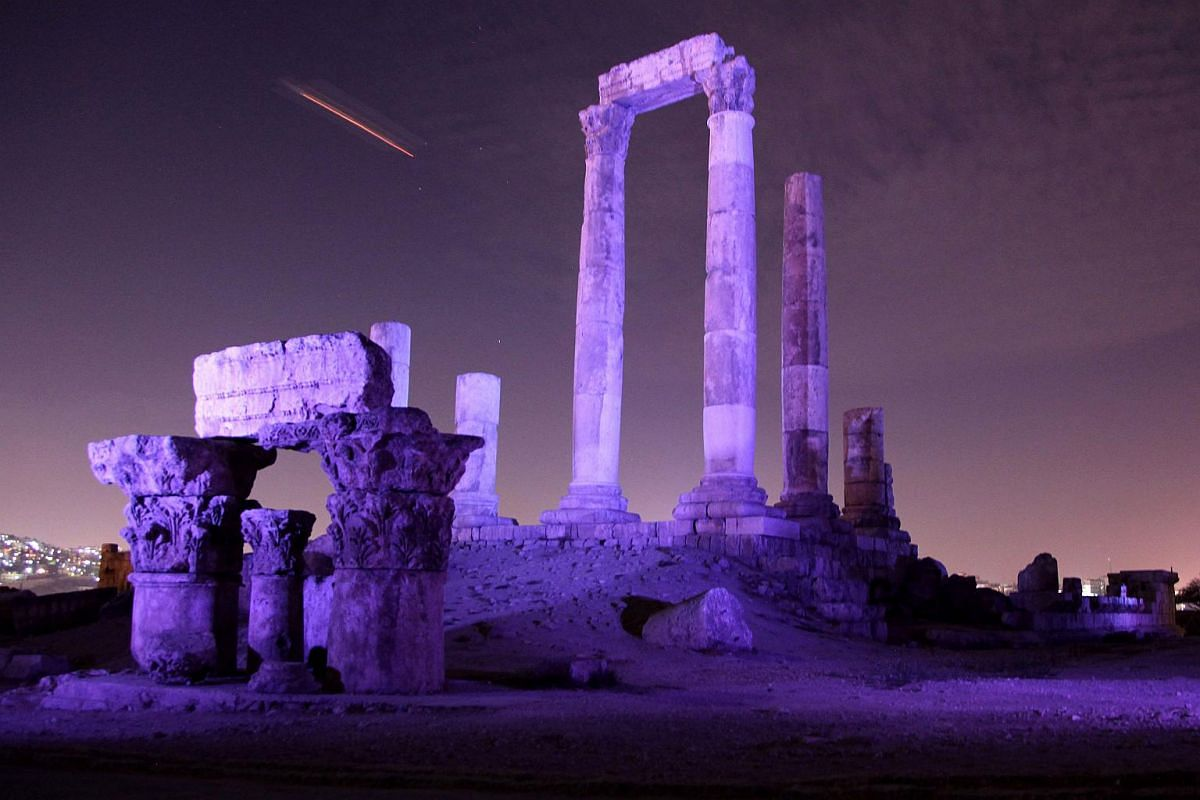 The Temple of Hercules at the Amman Citadel, Jordan, illuminated in blue light as part of the Turn the World UN Blue Campaign to celebrate the 70th anniversary of the United Nation.