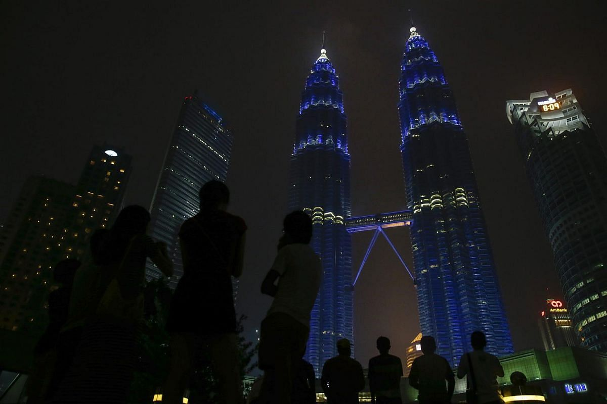 Kuala Lumpur's landmark Petronas Twin Towers are illuminated in blue, the official color of the United Nations, to mark the 70th anniversary of the UN, in Kuala Lumpur, Malaysia, on Oct 24, 2015.