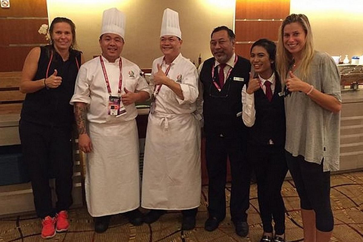 """Andrea Hlavackova (right) and doubles partner Lucie Hradecka finished their match past midnight on Sunday, but were thankful support staff were on site to ensure their dietary needs were met: """"Thanks for waiting so late to take care of us #WTAFinals #sing"""