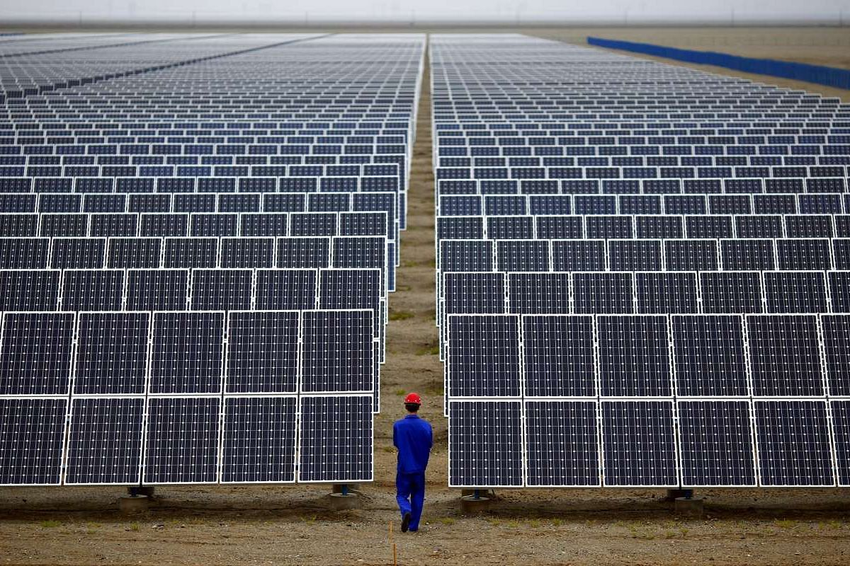 Solar panels in Dunhuang, Gansu province. China has invested heavily in hydro, wind and solar power and installed more renewable energy-generating capacity than any other nation.