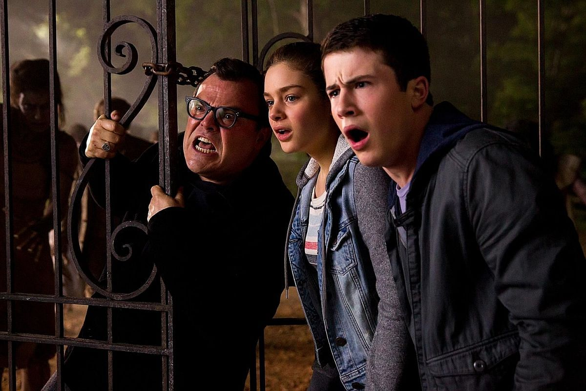 Jack Black (left) and his co-stars (from right) Dylan Minnette and Odeya Rush in Goosebumps.