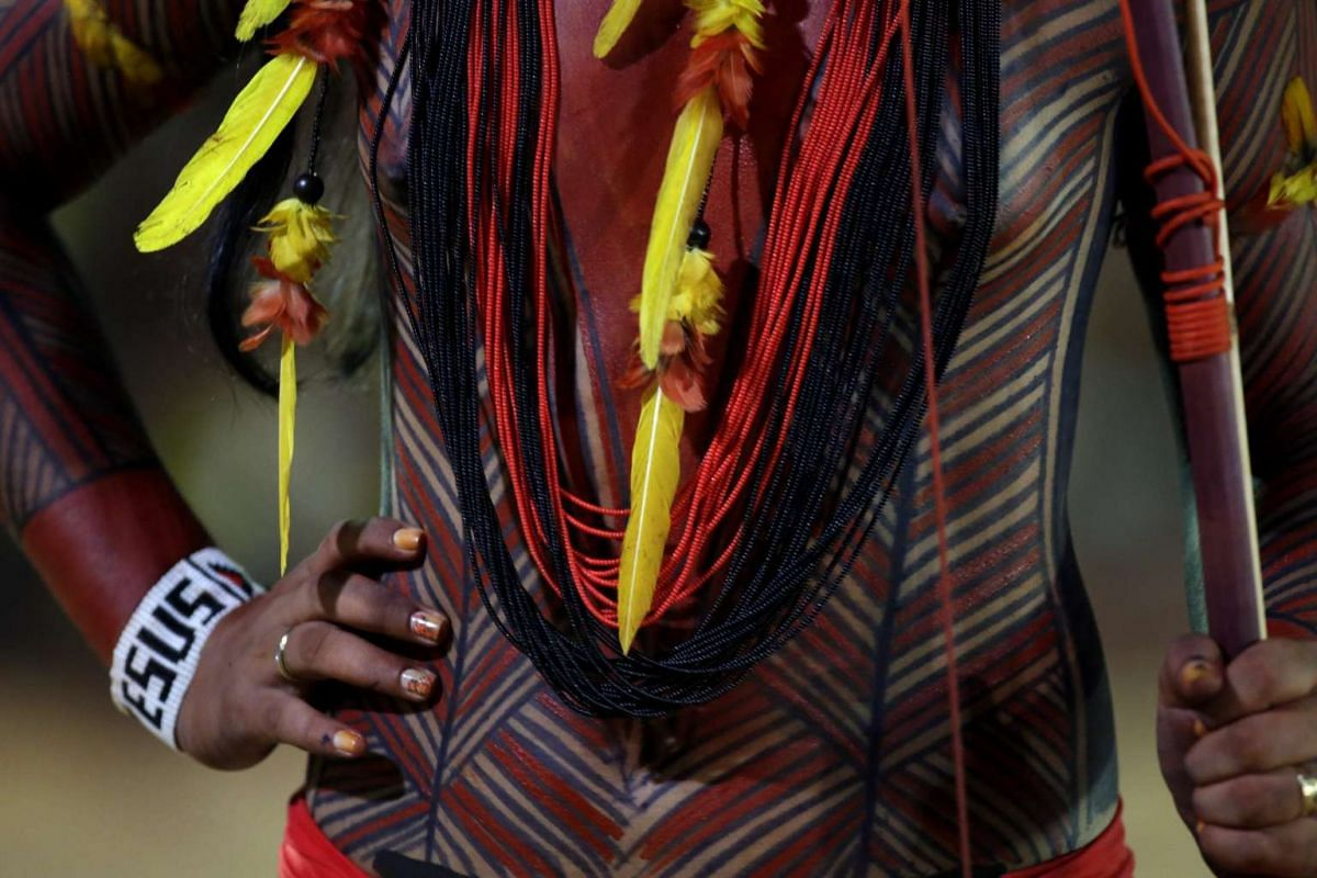 A Brazilian indigenous person attends a cultural event part of the World Indigenous Games, in Palmas, Brazil on Oct 24, 2015.