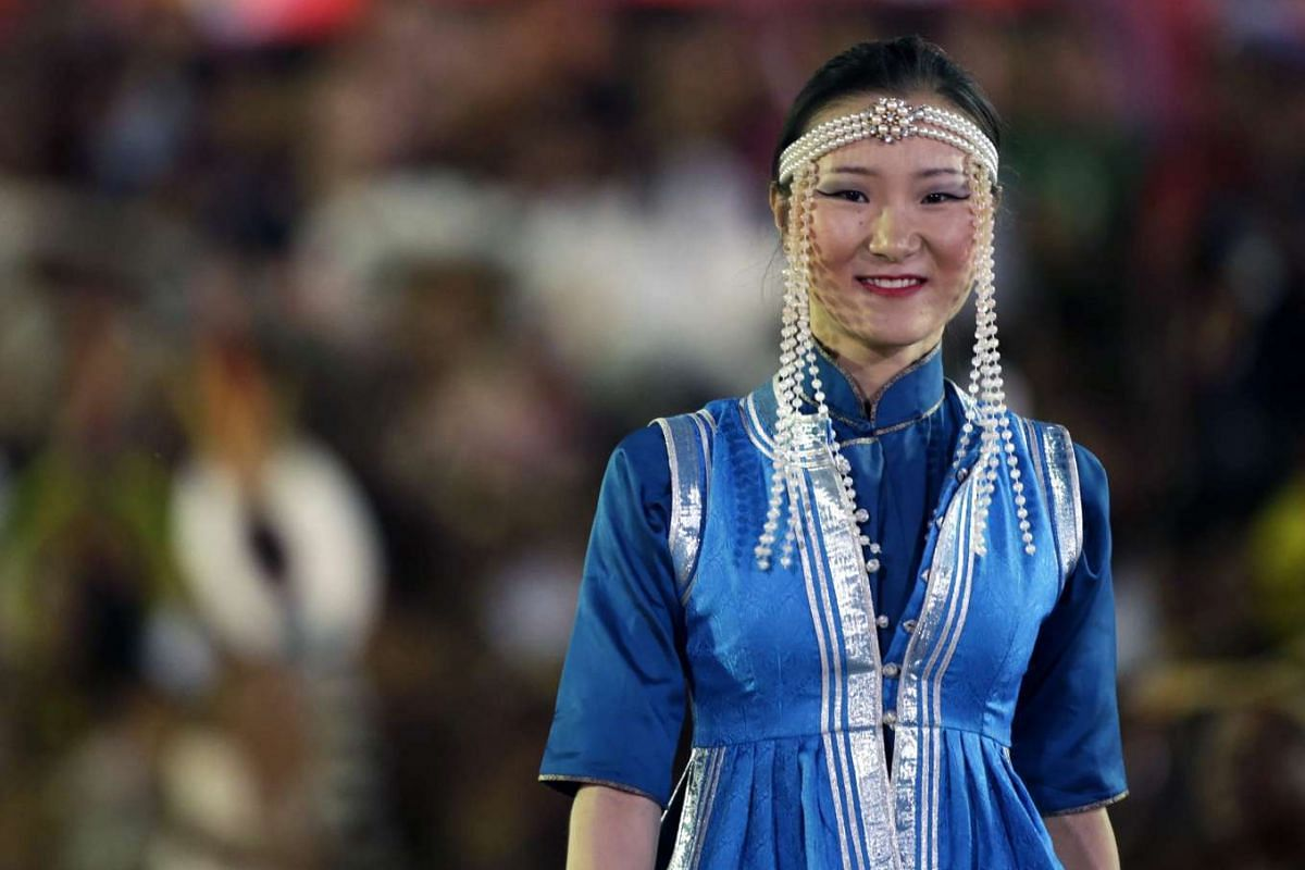 A Russian indigenous woman takes part in a parade of the World Indigenous Games, in Palmas, Brazil on Oct 24, 2015.