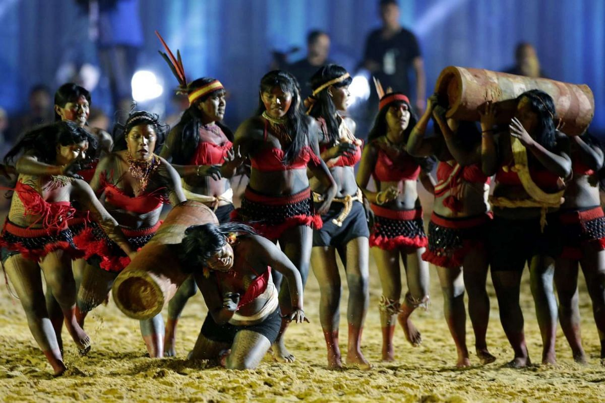 A woman falls during a trunk race competition during the opening ceremony of the World Indigenous Games, in Palmas, Brazil on Oct 23, 2015.