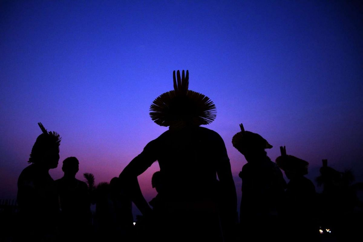 Brazilian indigenous of Kaypo ethnic people participate in traditional fire ceremony at the opening of the inaugural World Indigenous Games in Palmas, in northern Brazil on Oct 22, 2015.