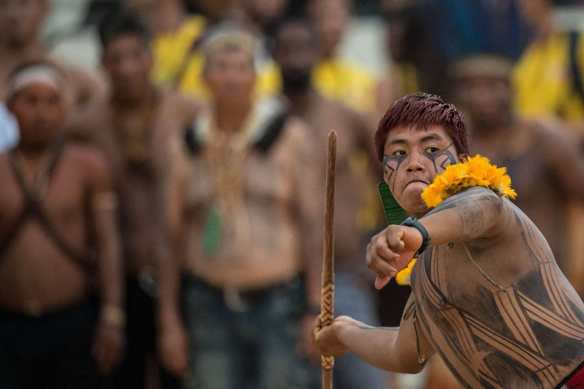 An indigenous native takes part in the javelin competition during the first World Indigenous Games in Palmas, Tocantins, Brazil on Oct 25, 2015.