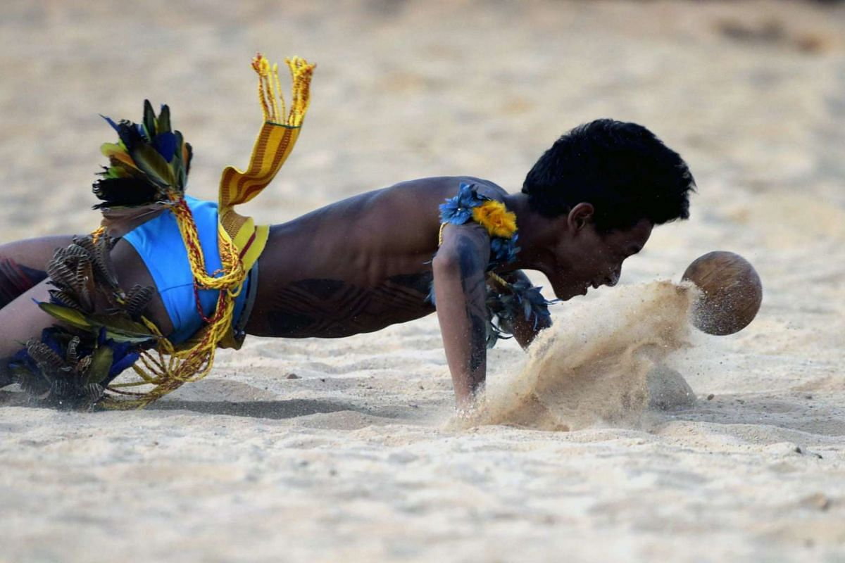 A Brazilian indigenous man of the ethnic group Paresi plays Xikunahati, a traditional sport also called hiara or head football, during the World Indigenous Games in Palmas, Brazil on Oct 26, 2015.