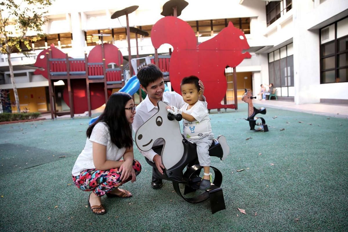 On July 30 this year, Jeremy, then 22 months old, is seen playing at the hospital playground, accompanied by his parents, Mr Guo Yang, 34, and Ms Maggie Yu, 33, two days before his liver transplant operation in NUH. Jeremy's tummy is bloated due to