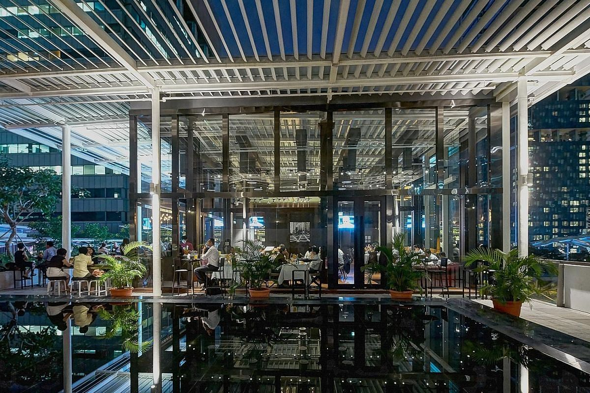 Dallas Restaurant & Bar (right) is one of 13 eateries at the Sky Garden in Suntec City.