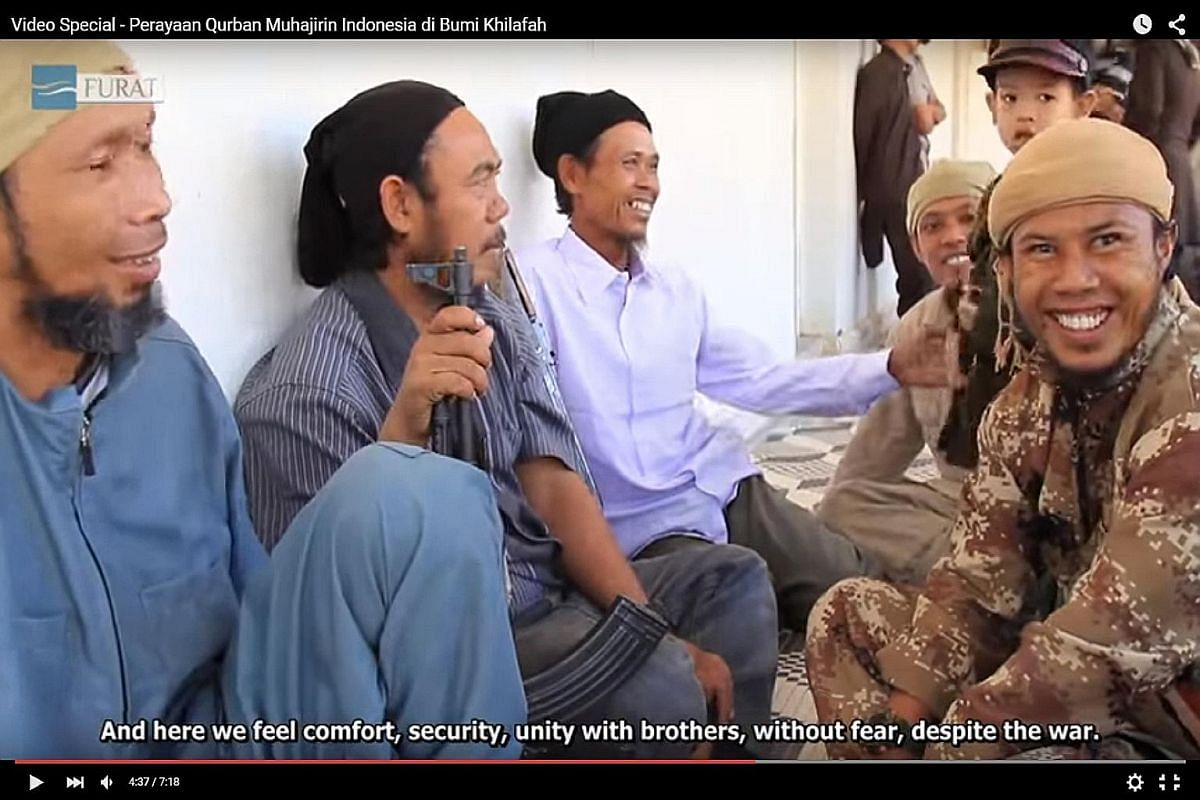 Screen grabs from YouTube videos produced by Furat Media, part of the Islamic State in Iraq and Syria's propaganda arm, show Indonesian Muslims celebrating Hari Raya Haji and urging fellow Muslims to emigrate to Syria and Iraq. The videos also show c