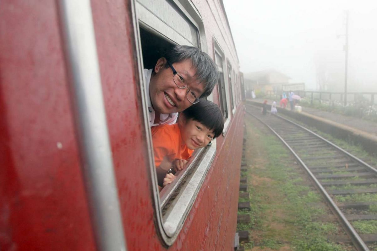 The writer's son (above) with his father on a local train in child-friendly Sri Lanka. A group of young men gave up their spot by the train window so he could get a better view.