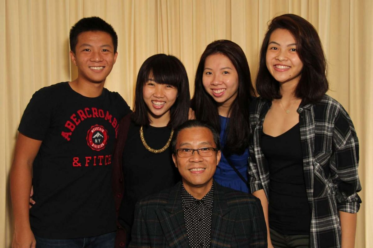 Ten years ago, when Mr Keith Leong's (above foreground) wife died of stomach cancer, his parents helped to care for his children – (from left) Daniel, 17, Esther, 22, Fiona, 19, and Crystal, 18.