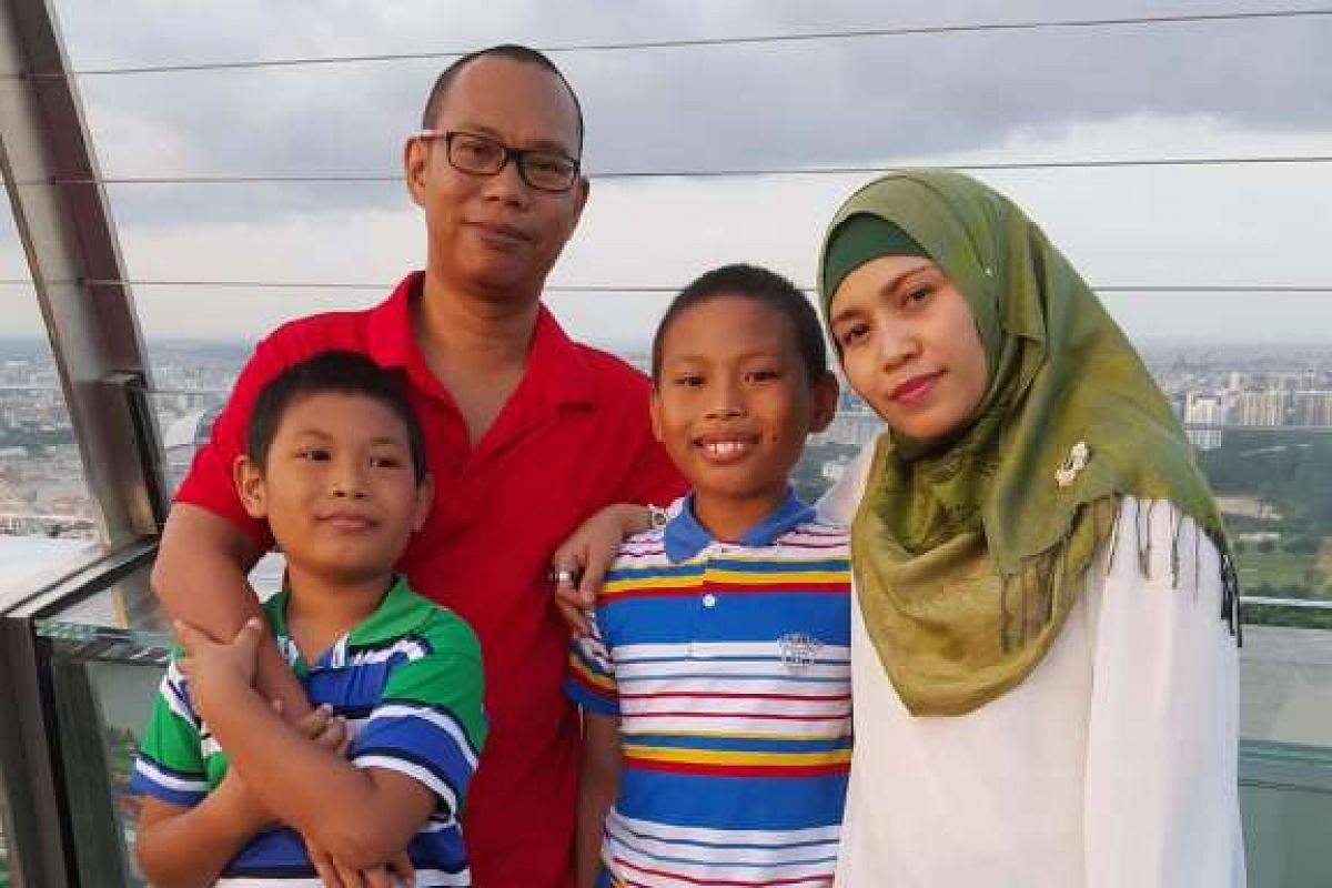 Ms Zulfa Anas, with her husband, Mr Norzulaini Abu, 46, and their sons Muhammad Firdaus (right), 12, and Muhammad Amin (left), nine. She has bone cancer and has talked to her sons about death.