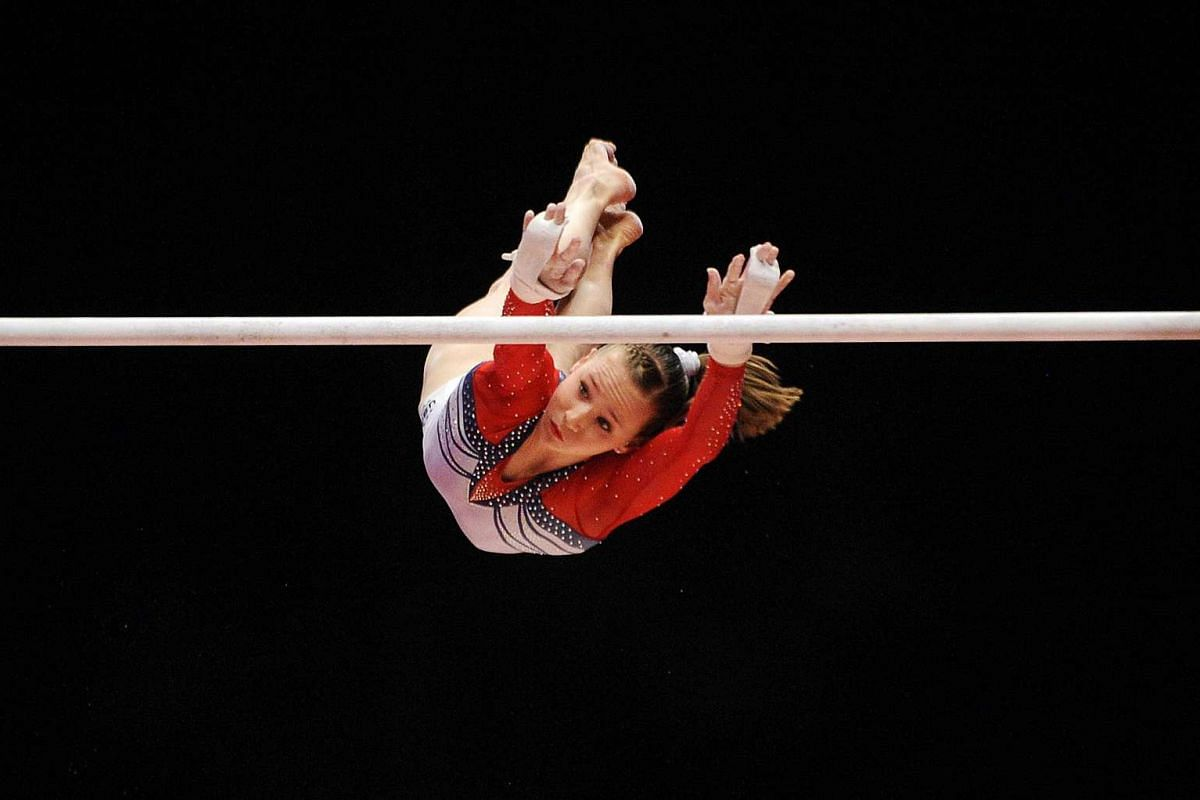US gymnast Madison Kocian on the uneven bars on Day 1 of the Women and Men's Apparatus Final.