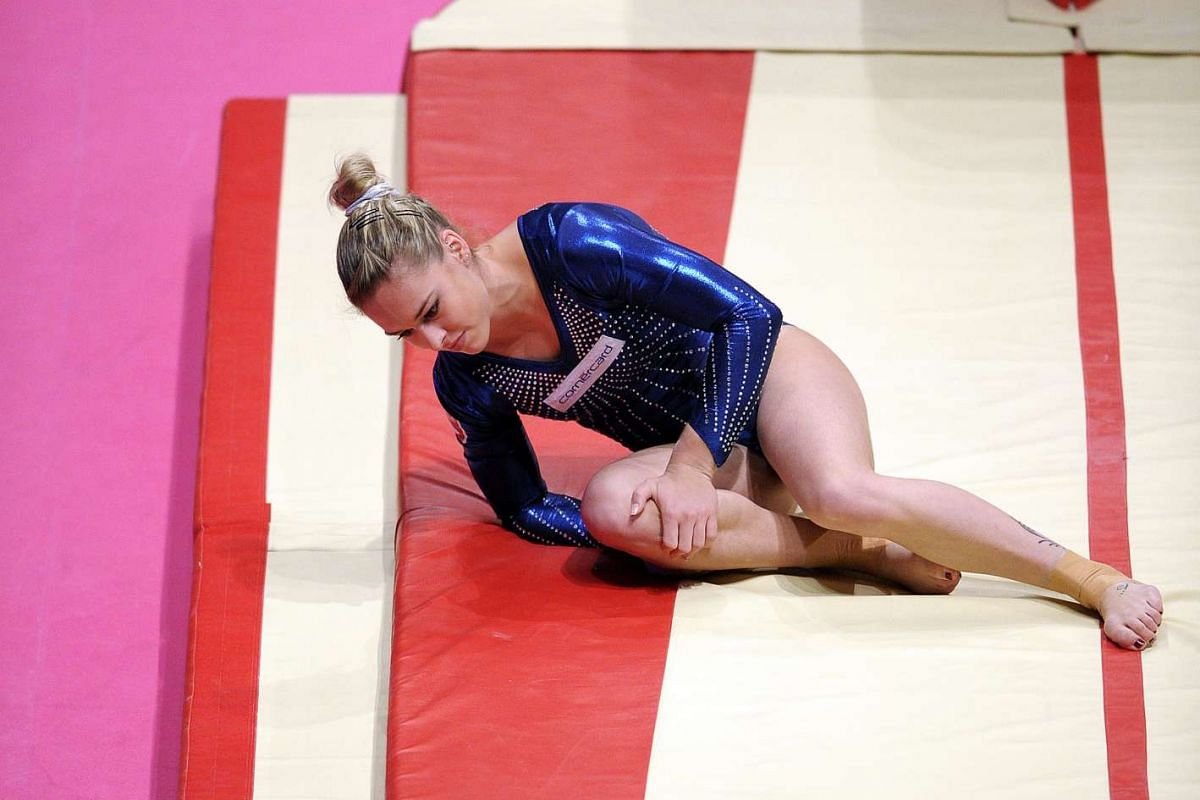 Switzerland's Giulia Steingruber holding her knee after being injured on the vault on Day 1 of the Women and Men's Apparatus Final.