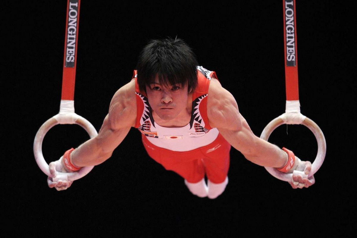 Japan's Kohei Uchimura on the rings on the third day of the 2015 World Gymnastics Championships.