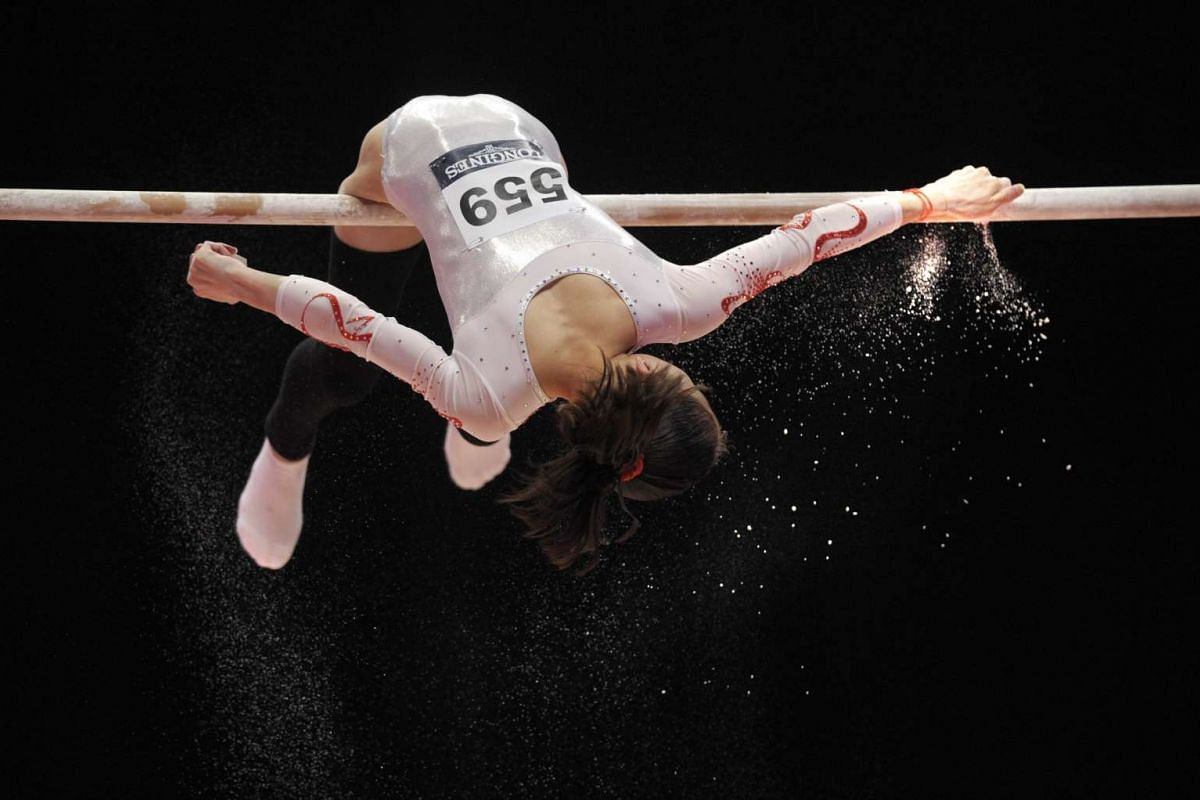 China's Shang Chunsong preparing to go on the uneven bars on the second day of the 2015 World Gymnastics Championships.