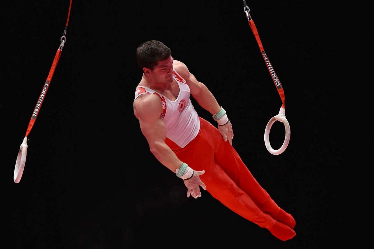 Canada's Kevin Lytwyn on the rings during the fourth day of the 2015 World Gymnastics Championship.