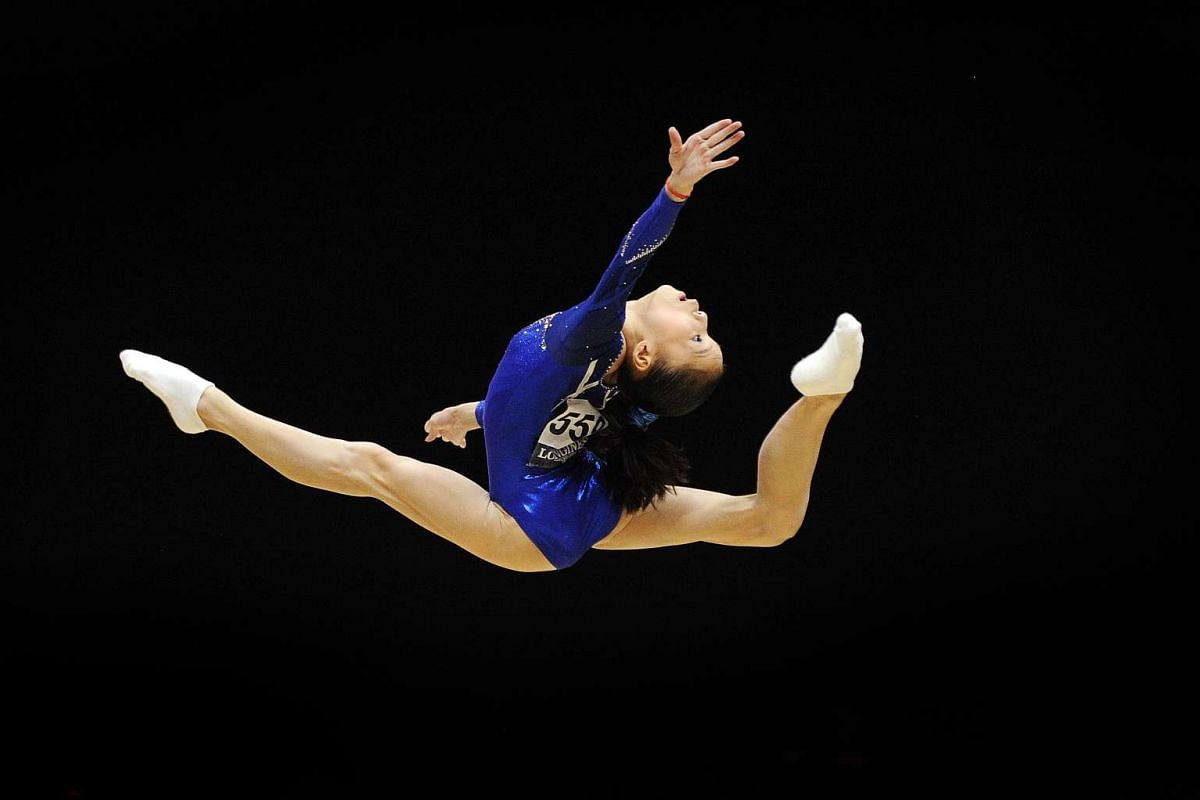Chinese gymnast Shang Chunsong perfoming her routine on the floor exercise during the Women's All-Around final on the seventh day of the 2015 World Gymnastics Championship.